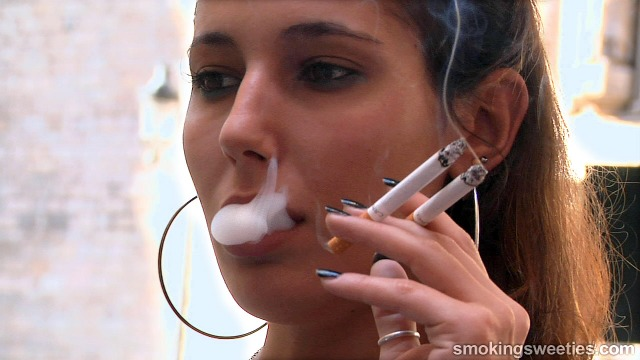 Elena: Smoking two cigarettes at once