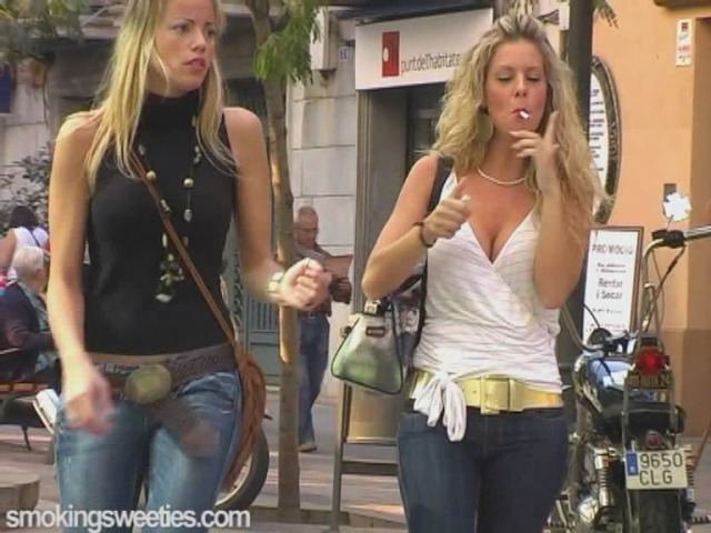 Cute cousins smoking on the street