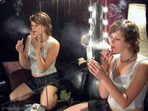 Olga double smoking on the mirror