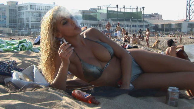 Vanessa: smoking on the beach.