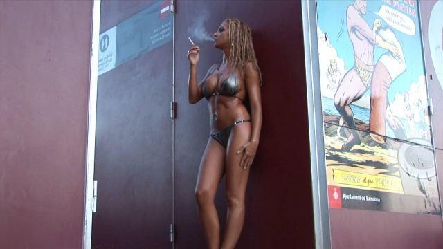 Vanessa: smoking on the beach.